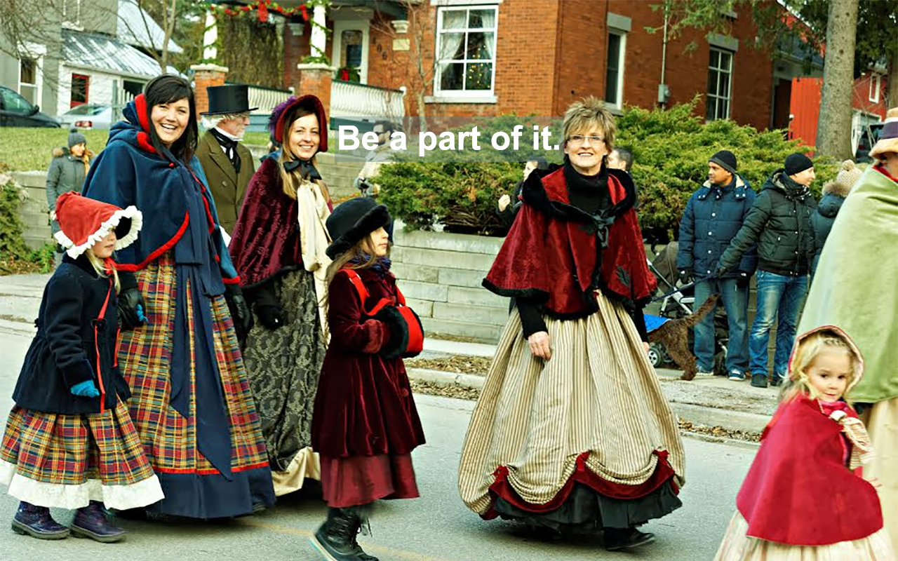 People in period costume walking in a parade