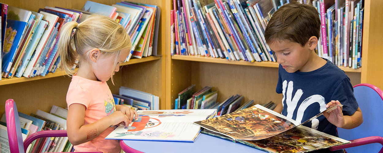 Children reading books in a library